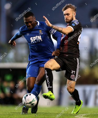 Stock Picture of Bohemians vs Waterford. Waterford's Maxim Kouogun and Luke Wade-Slater of the Bohemians