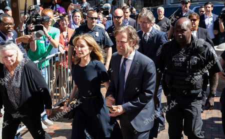 Actress Felicity Huffman (C-L) and her husband actor William H Macey (C-R) arrive at the John Joseph Moakley Federal Courthouse for her sentencing in connection with the college admission scandal in Boston, Massachusetts, USA, 13 September 2019. Felicity Huffman is involved in a nationwide scandal where a dozen of people are accused of being allegedly involved in admissions bribery.