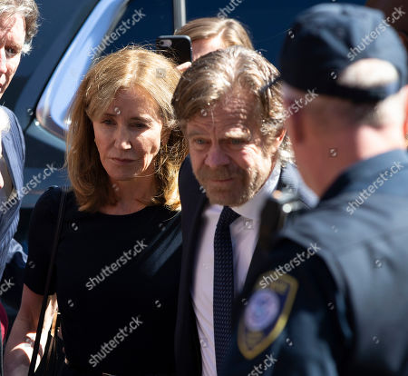 Actress Felicity Huffman (L) and her husband actor William H Macey (R) arrive at the John Joseph Moakley Federal Courthouse for her sentencing in connection with the college admission scandal in Boston, Massachusetts, USA, 13 September 2019. Felicity Huffman is involved in a nationwide scandal where a dozen of people are accused of being allegedly involved in admissions bribery.