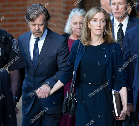 US actress Felicity Huffman (R) and her husband actor William H Macy (L) exit the John Joseph Moakley Federal Courthouse following her sentencing in connection with the college admission scandal in Boston, Massachusetts, USA, 13 September 2019. Huffman was sentenced to 14 days in prison, she has to pay 30,000 US dollars fine and do 250 hours of community service for her involvement in college admission scandal.