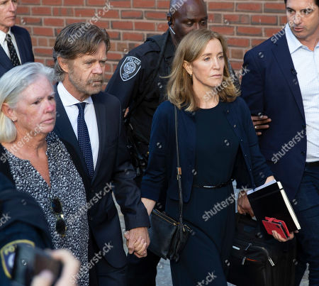 US actress Felicity Huffman (R) and her husband actor William H Macy (2-L) exit the John Joseph Moakley Federal Courthouse following her sentencing in connection with the college admission scandal in Boston, Massachusetts, USA, 13 September 2019. Huffman was sentenced to 14 days in prison, she has to pay 30,000 US dollars fine and do 250 hours of community service for her involvement in college admission scandal.