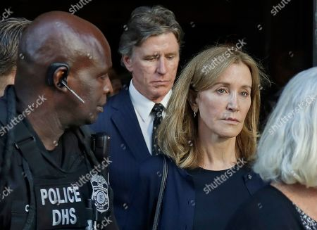Felicity Huffman, Moore Huffman Jr. Actress Felicity Huffman leaves federal court accompanied by her brother, Moore Huffman Jr., center, after her sentencing in a nationwide college admissions bribery scandal, in Boston