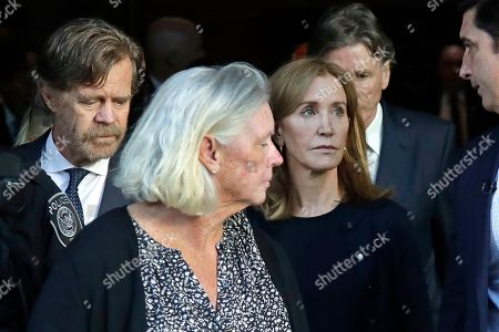 Felicity Huffman, William H Macy. Felicity Huffman, right, leaves federal court with her husband William H. Macy, far left, after her sentencing in a nationwide college admissions bribery scandal, in Boston