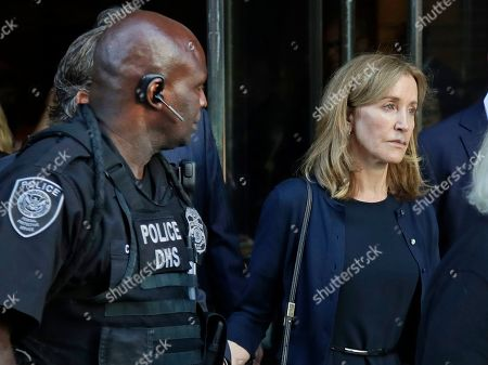 Felicity Huffman leaves federal court after her sentencing in a nationwide college admissions bribery scandal, in Boston