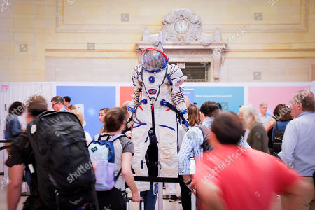 For ADT- Visitors at the Gallery of Valuables by ADT admire a space suit worn by astronaut Scott Kelly while on the International Space Station. The event took place in Grand Central Terminal's Vanderbilt Hall on in New York