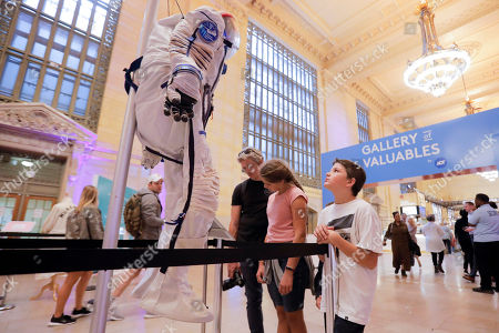 For ADT- A young boy visiting the Gallery of Valuables by ADT gazes up at a space suit worn by astronaut Scott Kelly when on a mission to the International Space Station. The event took place in Grand Central Terminal's Vanderbilt Hall on in New York