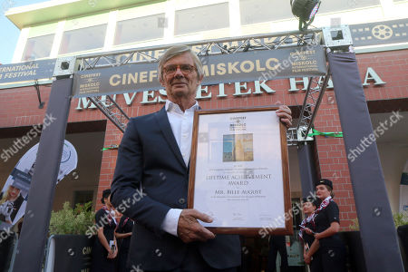 Stock Photo of Special guest Danish Academy Award-winning film and television director Bille August shows his newly acquired Lifetime Achievement Award of the 16th CineFest International Film Festival after its opening event in Miskolc, northeastern Hungary, 13 September 2019.