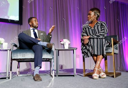 """Stock Image of Shermichael Singleton, left, political consultant, writer and commentator, and Joy-Ann Reid, right, host of MSNBC's """"AM Joy"""", discuss the power of Black women to promote change during a town hall forum hosted by The Black Women's Agenda, Inc. on in Washington. Founded in 1977, The Black Women's Agenda is a nonprofit 501(C)3 organization that generates awareness and support for issues that secure, protect, and advance the interests of Black women"""