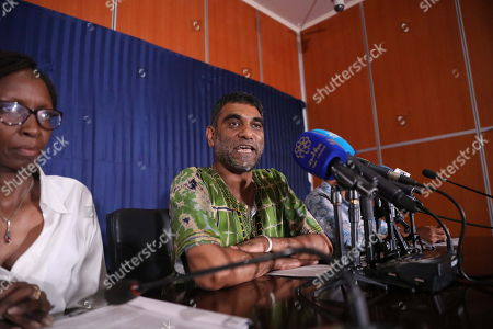 Amnesty International Secretary General Kumi Naidoo (R) speaks at a press conference at the Sudanese Ministry of Information, in Khartoum, Sudan, 13 September 2019. This is the first time Amnesty International is back in khartoum since 13 years. The visit comes in the wake of the formation of a new government and a power sharing deal between the army and the opposition in August 2019, following the uprising which resulted in the ousting of the then president Omar Hassan al-Bashir
