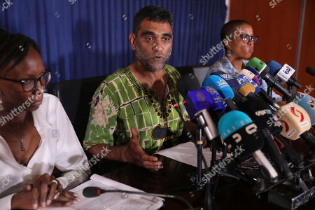 Amnesty International Secretary General Kumi Naidoo (C) speaks at a press conference at the Sudanese Ministry of Information, in Khartoum, Sudan, 13 September 2019. This is the first time Amnesty International is back in khartoum since 13 years. The visit comes in the wake of the formation of a new government and a power sharing deal between the army and the opposition in August 2019, following the uprising which resulted in the ousting of the then president Omar Hassan al-Bashir