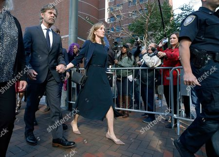 Felicity Huffman, William H. Macy. Felicity Huffman leaves federal court with her husband William H. Macy after she was sentenced in a nationwide college admissions bribery scandal, in Boston