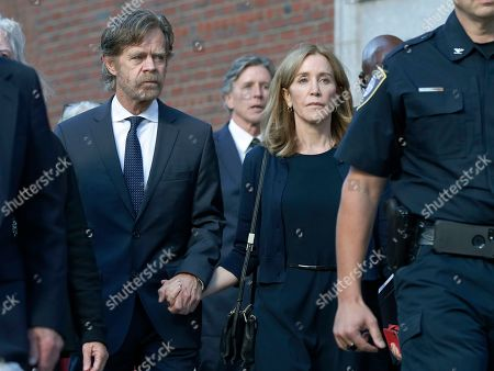 Felicity Huffman, William H. Macy, \ Moore Huffman Jr. Felicity Huffman leaves federal court with her husband William H. Macy, left, and her brother Moore Huffman Jr. rear center, after she was sentenced in a nationwide college admissions bribery scandal, in Boston