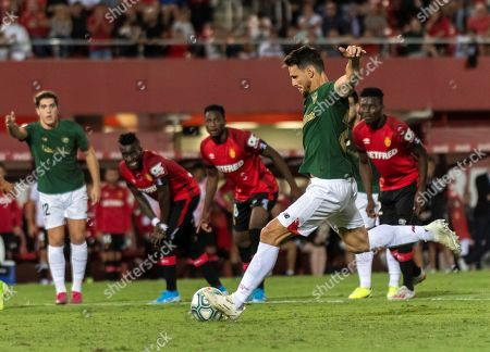 Stock Image of Athletic Bilbao's striker Aritz Aduriz shoots a penalty kick against RCD Mallorca, during a Spanish LaLiga soccer match between RCD Mallorca and Athletic Bilbao played at the San Moix stadium in Palma de Mallorca, Balearic Islands, Spain, 13 September 2019.