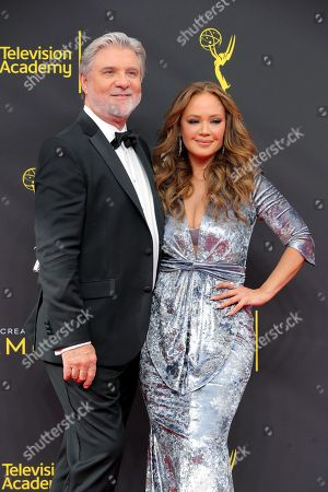 Stock Picture of Mike Rinder and Leah Remini