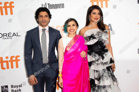 "Priyanka Chopra, Farhan Akhtar, Shonali Bose. From left, Farhan Akhtar, director Shonali Bose and actress Priyanka Chopra attend a premiere for ""The Sky Is Pink"" on day nine of the Toronto International Film Festival at Roy Thomson Hall, in Toronto"
