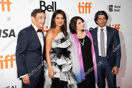 "Niren Chaudhary, Priyanka Chopra, Aditi Chaudhary, Farhan Akhtar. From left, Niren Chaudhary, Priyanka Chopra, Aditi Chaudhary, and Farhan Akhtar attend a premiere for ""The Sky Is Pink"" on day nine of the Toronto International Film Festival at Roy Thomson Hall, in Toronto"