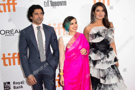 """Stock Picture of Farhan Akhtar, Shonali Bose, Priyanka Chopra. From left, Farhan Akhtar, director Shonali Bose and actress Priyanka Chopra attend a premiere for """"The Sky Is Pink"""" on day nine of the Toronto International Film Festival at Roy Thomson Hall, in Toronto"""