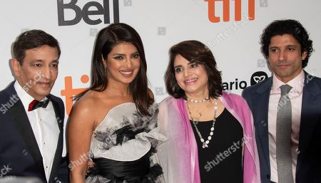 Stock Photo of Niren Chaudhary, Indian actress and cast member Priyanka Chopra, Aditi Chaudhary, and Indian actor and cast member Farhan Akhtar arrive for the premiere of the movie The Sky Is Pink during the 44th annual Toronto International Film Festival (TIFF) in Toronto, Canada, 13 September 2019. The festival runs from the 05 September to 15 September 2019.