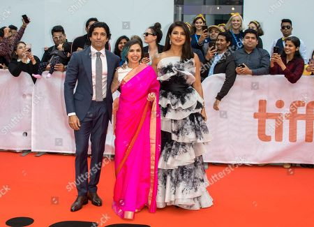 Stock Picture of Farhan Akhtar, Indian director Shonali Bose and Indian actress and cast member Priyanka Chopra arrive for the premiere of the movie The Sky Is Pink during the 44th annual Toronto International Film Festival (TIFF) in Toronto, Canada, 13 September 2019. The festival runs from the 05 September to 15 September 2019.