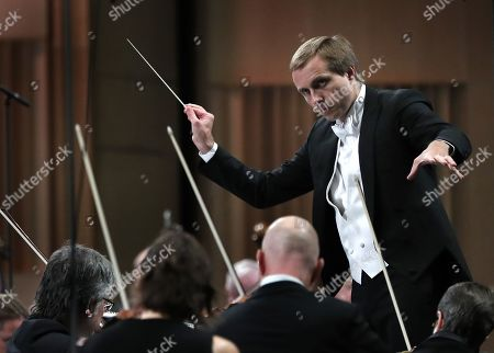 Stock Picture of Russian conductor Vasily Petrenko conducts the Oslo Philharmonic Orchestra as they perform Bartok's Concerto for orchestra Sz. 116 BB 123 during the George Enescu International Festival 2019 at the Great Palace Hall in Bucharest, Romania, 13 September 2019. The festival, held every two years since 1958, is the biggest classical music festival held in Romania, and is named after Romanian composer and violinist George Enescu.