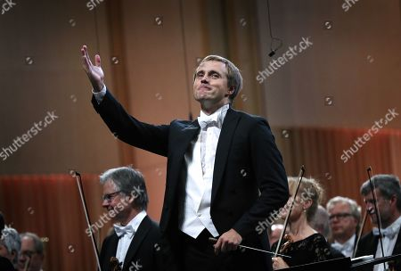 Stock Photo of Russian conductor Vasily Petrenko greets the audience after conducting the Oslo Philharmonic Orchestra during the George Enescu International Festival 2019 at the Great Palace Hall in Bucharest, Romania, 13 September 2019. The festival, held every two years since 1958, is the biggest classical music festival held in Romania, and is named after Romanian composer and violinist George Enescu.