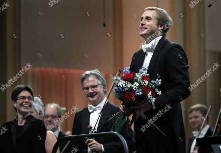 Russian conductor Vasily Petrenko greets the audience after conducting the Oslo Philharmonic Orchestra during the George Enescu International Festival 2019 at the Great Palace Hall in Bucharest, Romania, 13 September 2019. The festival, held every two years since 1958, is the biggest classical music festival held in Romania, and is named after Romanian composer and violinist George Enescu.