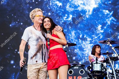 Kevin Cronin; Holly Cronin. Holly Cronin performs with her father Kevin Cronin of REO Speedwagon during KAABOO 2019 at the Del Mar Racetrack and Fairgrounds, in San Diego, Calif