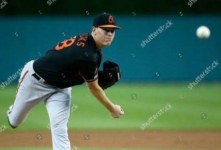 Baltimore Orioles' Aaron Brooks throws a warmup pitch before the second inning of a baseball game against the Detroit Tigers, in Detroit