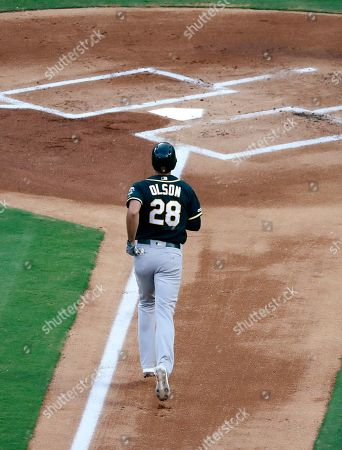 Oakland Athletics' Matt Olson jogs home after hitting a solo home run off of Texas Rangers' Brock Burke during the first inning of a baseball game in Arlington, Texas