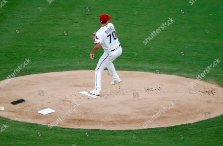 Texas Rangers starting pitcher Brock Burke throws to the Oakland Athletics in the first inning of a baseball game in Arlington, Texas