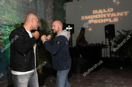 Sean Evans, right, and Cain Velasquez, left, face off at the Schick Xtreme: Baldest Party Ever during New York Fashion Week, in New York