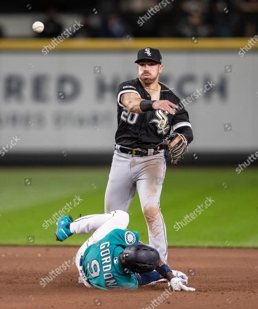 Chicago White Sox second baseman Danny Mendick is unable to turn a double play after forcing out Seattle Mariners' Dee Gordon at second base on a ball hit by Mallex Smith during the fourth inning of a baseball game, in Seattle