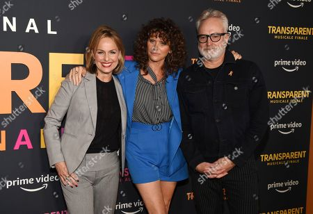"""Stock Photo of Melora Hardin, Amy Landecker, Bradley Whitford. From left, actresses Melora Hardin and Amy Landecker pose with Landecker's husband, actor Bradley Whitford, at the premiere of the Amazon Prime Video movie """"Transparent Musicale Finale"""" at the Regal Cinemas L.A. Live, in Los Angeles"""