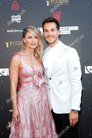Melissa Benoist (L) and her husband US actor Chris Wood arrive for the 45th annual Saturn Awards at The Avalon Hollywood in Los Angeles, California, USA, 13 September 2019. The Saturn Awards honors the best in science fiction, fantasy, horror and other genres in film, television, home media releases and theater.