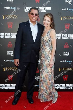 Dean Devlin (L) and US actress Lisa Brenna arrive for the 45th annual Saturn Awards at The Avalon Hollywood in Los Angeles, California, USA, 13 September 2019. The Saturn Awards honors the best in science fiction, fantasy, horror and other genres in film, television, home media releases and theater.