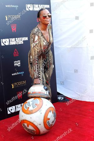 Aisha Tyler poses next to Star Wars character BB-8 as she arrives for the 45th annual Saturn Awards at The Avalon Hollywood in Los Angeles, California, USA, 13 September 2019. The Saturn Awards honors the best in science fiction, fantasy, horror and other genres in film, television, home media releases and theater.