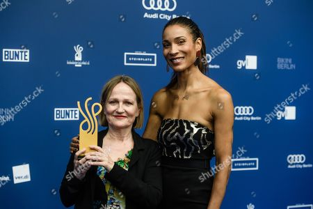 Stock Image of German actress Barbara Krabbe (L) poses with her award in the category 'Starker Auftritt' next to German actress Annabelle Mandeng during the German Drama Award (Deutscher Schauspielpreis) ceremony in Berlin, Germany, 13 September 2019 (issued 14 September 2019).
