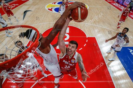 Dominik Olejniczak (R) of Poland in action against Myles Turner (L) of US during the FIBA Basketball World Cup 2019 classification match between the USA and Poland in Beijing, China, 14 September 2019.