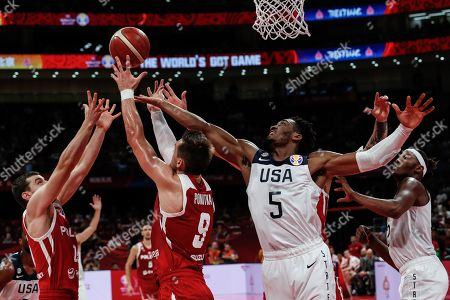 Donovan Mitchell (C-R) of US in action against Mateusz Ponitka (C-L) of Poland during the FIBA Basketball World Cup 2019 classification match between the USA and Poland in Beijing, China, 14 September 2019.