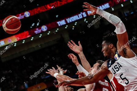 Donovan Mitchell (R) of US in action against Mateusz Ponitka (C) of Poland during the FIBA Basketball World Cup 2019 classification match between the USA and Poland in Beijing, China, 14 September 2019.