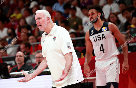 US head coach Gregg Popovich (L) rests while Derrick White of US looks on during the FIBA Basketball World Cup 2019 classification match between USA and Poland in Beijing, China, 14 September 2019.