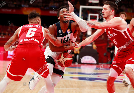 Donovan Mitchell (C) of US in action against A.J. Slaughter (L) and Aaron Cel of Poland during the FIBA Basketball World Cup 2019 classification match between USA and Poland in Beijing, China, 14 September 2019.