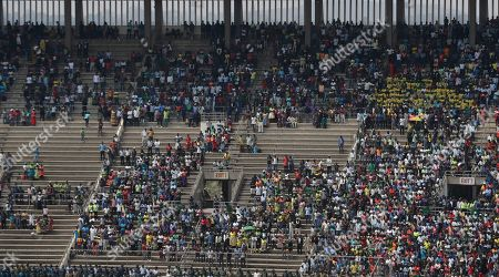 Mourners attend the funeral service for Former Zimbabwean President Robert Mugabe at the National Sports Stadium in Harare, . African heads of state and envoys are gathering to attend a state funeral for Mugabe, whose burial has been delayed for at least a month until a special mausoleum can be built for his remains