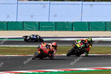 Spanish MotoGP rider Marc Marquez (L) of Repsol Honda Team and Italian MotoGP rider Andrea Iannone of Aprilia Racing Team Gresini in action during the third practice session of the 2019 Motorcycling Grand Prix of San Marino and Riviera di Rimini at Misano Circuit in Misano Adriatico, Italy, 14 September 2019.