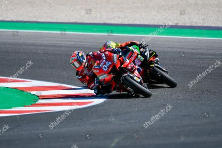 Italian MotoGP rider, number 4 ,Andrea Dovizioso (L), of the Ducati Team and Spanish MotoGP rider, number 41 Aleix Espargaro, of the Aprilia Racing Team Gresini in action during the free practice/qualifying session of the 2019 Motorcycling Grand Prix of San Marino and Riviera di Rimini at Misano Circuit in Misano Adriatico, Italy, 14 September 2019.