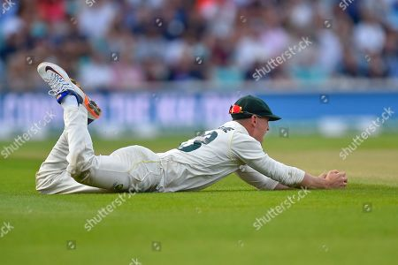 Wicket - Marnus Labuschagne of Australia catches Jos Buttler of England off the bowling of Peter Siddle of Australia during the 5th International Test Match 2019 match between England and Australia at the Oval, London