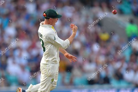 Wicket - Marnus Labuschagne of Australia celebrates catching Jos Buttler of England off the bowling of Peter Siddle of Australia during the 5th International Test Match 2019 match between England and Australia at the Oval, London