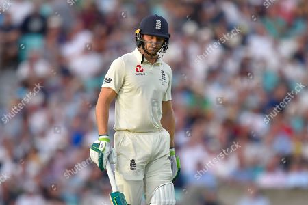 Wicket - Jos Buttler of England looks dejected as he walks back to the pavilion after being dismissed by Peter Siddle of Australia during the 5th International Test Match 2019 match between England and Australia at the Oval, London