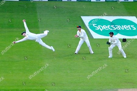 Wicket - Steve Smith of Australia takes a spectacular catch to dismiss Chris Woakes of England off the bowling of Mitchell Marsh of Australia during the 5th International Test Match 2019 match between England and Australia at the Oval, London