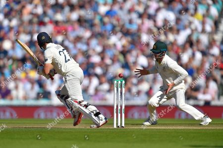 Rory Burns of England hits the ball towards Cameron Bancroft of Australia who is fielding in place of Marcus Harris of Australia who had stitches in his hand after a dropped catch yesterday during the 5th International Test Match 2019 match between England and Australia at the Oval, London